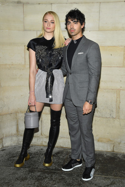 Sophie Turner Over the Knee Boots [clothing,fashion,footwear,tights,leggings,outerwear,riding boot,leg,knee,fashion design,joe jonas,sophie turner,front row,part,paris,france,louis vuitton,paris fashion week womenswear spring]