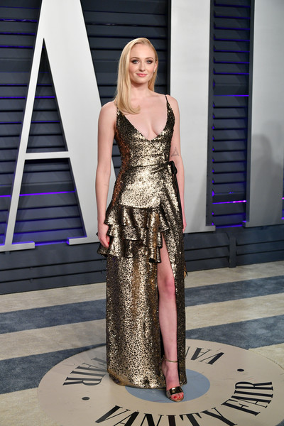 Sophie Turner Sequin Dress [fashion model,clothing,fashion,dress,shoulder,beauty,haute couture,yellow,fashion show,blond,radhika jones - arrivals,radhika jones,sophie turner,beverly hills,california,wallis annenberg center for the performing arts,oscar party,vanity fair,kendall jenner,91st academy awards,wallis annenberg center for the performing arts,oscar party,vanity fair,academy awards,party,model,elton john aids foundation academy award party]