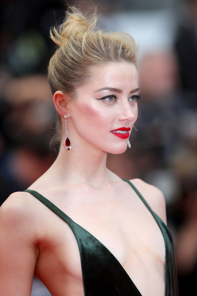 Amber Heard wore her hair in a punky top knot at the Cannes Film Festival screening of 'Sorry Angel.'