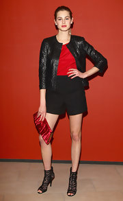 Vanessa wears a cropped leather jacket with black shorts for the Italian movie premiere.