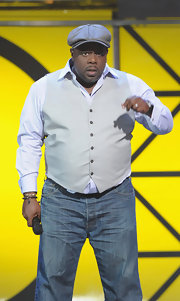 Cedric the Entertainer looked spiffy in a light gray vest over a white shirt.