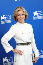 Jane Fonda styled her white jumpsuit with a metallic gold belt by Alberta Ferretti for the Venice Film Festival photocall for 'Our Souls at Night.'