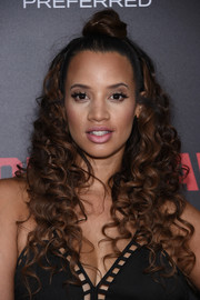 Dascha Polanco wore a fun and flirty half-up style, featuring a bun at the top and a cascade of curls, during the New York premiere of 'Southpaw.'