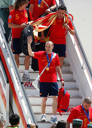 Andres Iniesta trimmed his hair into a neat buzzcut before returning to Spain with the World Cup.