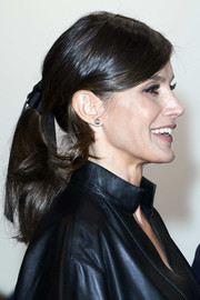 Queen Letizia accessorized with a pair of classic diamond studs.