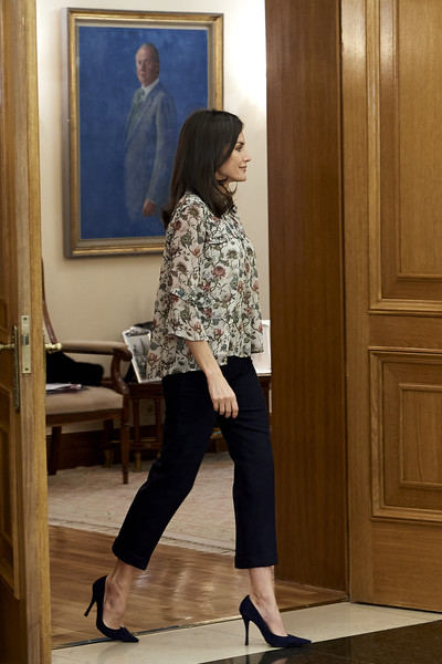 Queen Letizia of Spain paired black capris with a floral blouse for an audience at Zarzuela Palace.