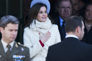 Queen Letizia of Spain bundled up in a white scarf and a matching coat for the Commemoration of Capitulations of Valladolid.