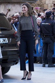 Queen Letizia of Spain paired her blouse with high-waisted nautical pants by Hugo Boss.