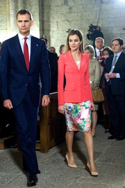 Princess Letizia teamed a fitted coral jacket with a floral dress for the Marques de Viana Awards.