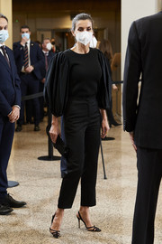 Queen Letizia of Spain looked elegant in a black Manuel Pertegaz blouse with statement sleeves at the 'In Memoriam' concert.
