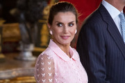 Queen Letizia matched her dress with a pair of oversized pink studs.