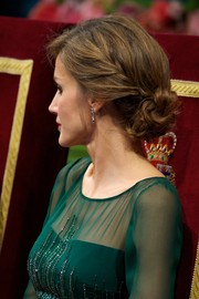 Princess Letizia was romantically coiffed with a loose braid cascading down into low bun during the Principes de Asturias Awards.