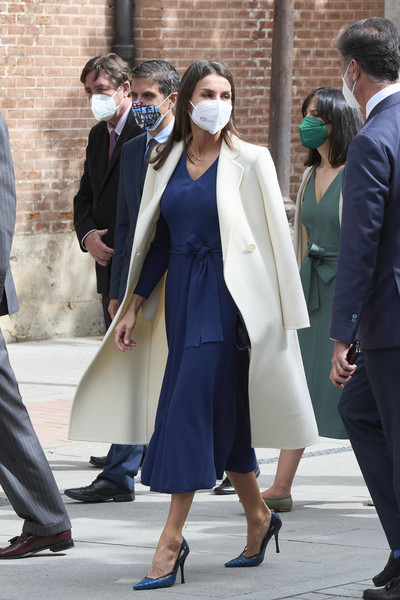 Queen Letizia of Spain arrived for her visit to the Cervantes Institute wearing a cream wool coat over a navy midi dress.