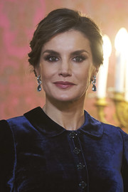 Queen Letizia of Spain polished off her look with a pair of dangling aquamarine earrings by Bulgari.
