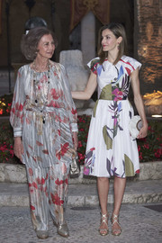 Queen Letizia of Spain looked vibrant in a colorful print dress by Juan Vidal while hosting a dinner in Palma de Mallorca.