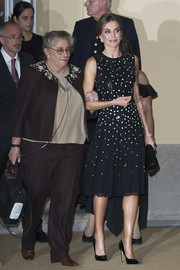 Queen Letizia of Spain cut a chic figure, as always, in a Carolina Herrera midi dress rendered in black sequins and white paillettes while attending a reception in her honor offered by the Israeli President.