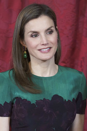 Queen Letizia of Spain's Bounkit amethyst and jade earrings were a perfect match to her floral dress!