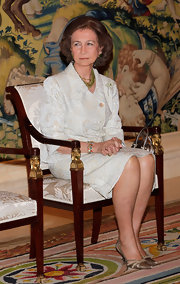 Queen Sofia adds some color with this gemstone beaded bracelet.