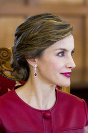 Queen Letizia of Spain matched her outfit with a pair of ruby and diamond drop earrings.