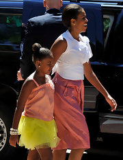 Sasha Obama charmed in a yellow tutu skirt and coral camisole on a visit to the Marivent Palace.