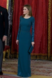 Princess Letizia went matchy-matchy with this teal suede clutch and gown combo.