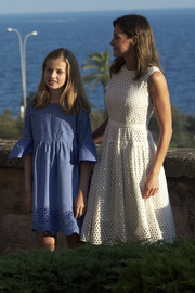 Queen Letizia of Spain looked airy in a sleeveless white eyelet dress by Hugo Boss during a summer photocall in Palma de Mallorca.