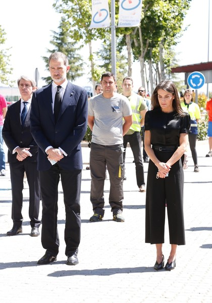 Queen Letizia of Spain kept it subdued in a short-sleeve black satin blouse and matching capris while visiting the Coslada Transport Center.