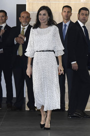 Queen Letizia of Spain chose a dotted white midi dress by Emporio Armani for the scientific congress of the 50th anniversary commemoration of the Donana National Park.