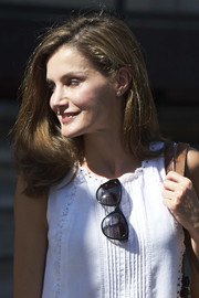 Queen Letizia of Spain looked summer-chic in her white shift dress and butterfly sunnies while visiting the Can Prunera Musuem in Palma de Mallorca.