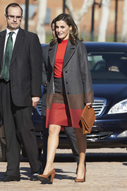 Queen Letizia of Spain styled her suit with chunky-heeled tan pumps.