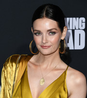 Lydia Hearst sported a simple center-parted ponytail at the special screening of 'The Walking Dead' season 10.