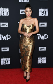 Christian Serratos looked ultra sophisticated in a strapless gold jacquard dress at the special screening of 'The Walking Dead' season 10.