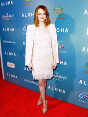 Deviating from her white motif, Emma Stone chose gray Christian Louboutin pumps for her footwear.