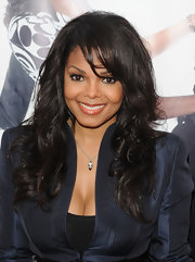 The iconic singer sported a tousled curl hairstyle with piecey swing bangs. This style showed off her layers and created a great frace framing look.