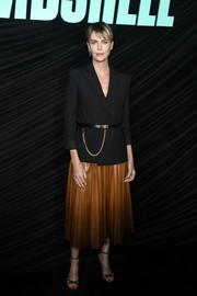 Charlize Theron sealed off her look with strappy black sandals.