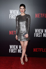 Alexandra Daddario matched her dress with a pair of silver ankle-strap sandals.