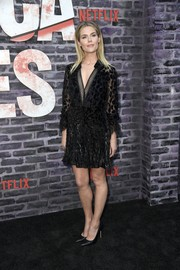 Rachael Taylor attended the special screening of 'Jessica Jones' season 3 wearing a black V-neck cocktail dress by Self-Portrait.