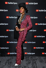 Janelle Monae rocked a black and fuchsia suit that featured a mix of zebra and pin stripes at the special screening of 'Dirty Computer.'