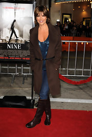 "Lisa Rinna wore a cuddly wool trench to a screening of 'NINE"". The brown jacket was kept from looking to boxy by a carefully placed leather belt."