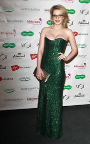 Helen Flanagan revved up her look in a sparkly green strapless dress at an event in London.