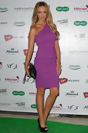 Lauren attended the Spectacle Wearer of the Year Awards wearing a figure flattering mini dress in a bright purple shade.