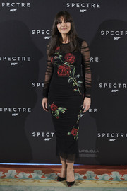 Monica Bellucci was all about gothic romance in a sheer-sleeve black rose-print dress by Dolce & Gabbana at the 'Spectre' Madrid photocall.