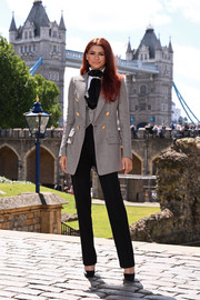 Zendaya Coleman completed her outfit with black high-waisted trousers.