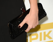 "Jessica Alba stashed her essentials in Christian Louboutin's spiked ""Miss Loubi"" clutch at Spike TV's 2012 Video Game Awards."