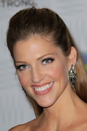 Tricia Helfer added some gleam to her look with cluster diamond earrings.