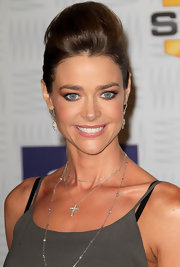 Denise Richards paired her sleek look with a diamond clad pendant cross necklace. This seems to be one of Denise's facorite gems, as she's seen wearing it quite often.
