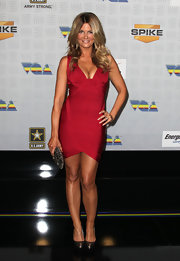 Courtney Hansen dazzled in metallic bronze pumps. The heels gave her rasberry bandage dress the perfect amount of shine.