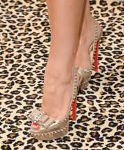 Courtney Hansen showed off her edgy side with this gold peep-toe pumps that featured studs and a bow.