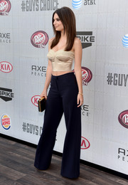 Emily Ratajkowski topped off her head-turning ensemble with a black and gold box clutch by Halston Heritage.