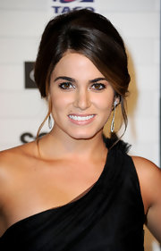 Nikki Reed highlighted her one-shoulder dress with a side swept French twist.